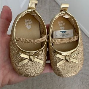 Glittery gold baby shoes
